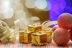 Christmas balls and gift with ribbon on abstract background. Stock Photography