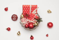 Christmas. Balls and gifts in the basket Royalty Free Stock Image