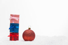 Christmas balls with gifts Royalty Free Stock Images