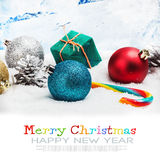 Christmas balls and gifts on snow isolated  white Stock Photography