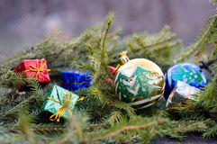 Christmas balls and gifts about spruce branches Stock Photography