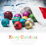 Christmas balls and gifts under the Christmas tree Royalty Free Stock Images