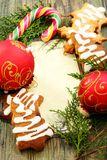 Christmas balls, gingerbread and candy cane. Stock Images