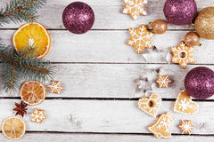 Christmas balls, gingerbread and dried oranges Royalty Free Stock Images