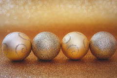 Christmas balls on glitter background Royalty Free Stock Photos
