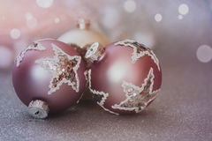Christmas balls on glitter holiday background Stock Image