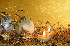 Christmas balls on a gold background stock image