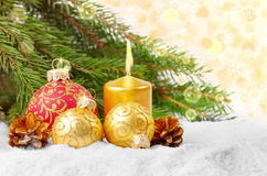 Christmas balls and gold candle Stock Photography