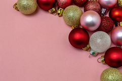 Christmas balls gold red pink on pink background Christmas new year postcard stock images