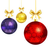 Christmas balls with gold ribbon and bows Stock Images