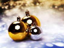 Christmas balls, gold, silver. Christmas balls on white. Gold and silver balls on holiday glittering background Royalty Free Stock Photography