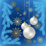 Christmas balls and gold snowflakes on a blue Stock Images