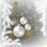 Christmas balls and gold snowflakes on a grey Stock Photos