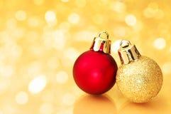 Christmas balls on gold sparkle background. stock photos