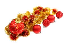 Christmas balls and a gold tinsel. Stock Photo