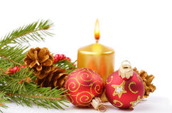 Christmas balls and golden candle Stock Photo