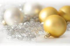 Christmas balls - golden and silver Stock Photos