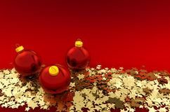 Christmas balls and golden stars. On red background Stock Images