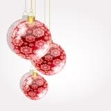 Christmas balls on golden strings Stock Photos