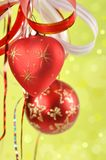 Christmas balls on a green background Royalty Free Stock Image