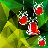 Christmas balls green background. Christmas balls on a bright green polygonal background Royalty Free Stock Image