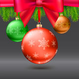 Christmas balls, green fir branches, bow, dark background Royalty Free Stock Image