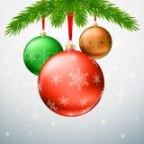 Christmas balls, green fir branches, bow, snowflake background. Gold Christmas balls with green fir branches on the background made of snowflake. Realistic Stock Photography