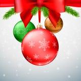 Christmas balls, green fir branches, bow, snowflake background. Gold Christmas balls with green fir branches and bow on the background made of triangles Stock Photos