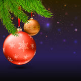 Christmas balls, green fir branches and bright background. Christmas balls with green fir branches on the background with flash and Christmas lights. Realistic Stock Photography