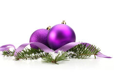 Christmas balls and green spruce branch stock images