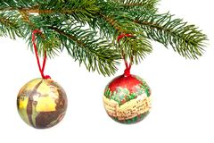 Christmas balls on a green spruce branch. Christmas balls with decoration on a green spruce branch Stock Image