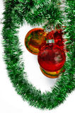 Christmas balls on a green tinsel Stock Photography
