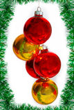 Christmas balls on a green tinsel Royalty Free Stock Photo