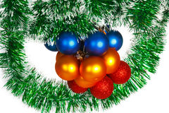 Christmas balls on a green tinsel Royalty Free Stock Images
