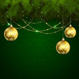 Christmas balls on green wallpaper Royalty Free Stock Photos