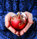 Christmas balls in hands Royalty Free Stock Image