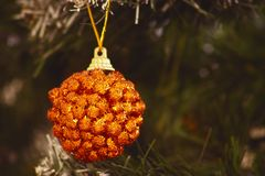 Christmas balls hang on the Christmas tree. The lights flash royalty free stock images
