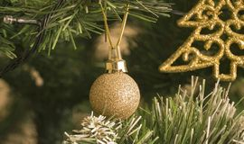 Christmas balls hang on the Christmas tree. The lights flash royalty free stock photos