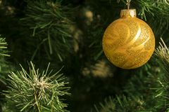 Christmas balls hang on the Christmas tree. The lights flash stock photography