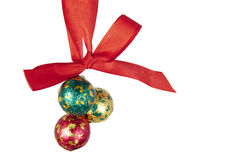 Christmas balls hanging on celebratory ribbon Stock Images