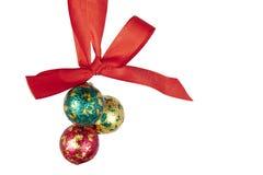Christmas balls hanging on celebratory ribbon Stock Images