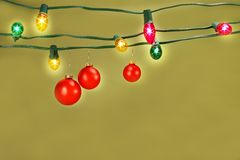 Christmas balls hanging on lights Stock Image