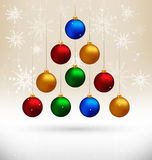 Christmas balls hanging like fir tree on beige. Ten multicolored Christmas balls hanging like fir tree on beige background with snowflakes Royalty Free Stock Photos