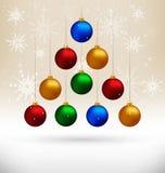 Christmas balls hanging like fir tree on beige Royalty Free Stock Photos