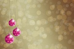 Christmas balls hanging on the paper background Royalty Free Stock Photography