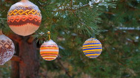 Christmas balls hanging on pine branches covered with snow stock video