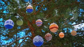 Christmas balls hanging on pine branches covered with snow stock video footage
