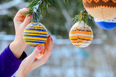 Christmas balls hanging on pine branches covered with snow stock image