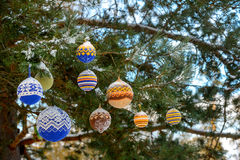 Christmas balls hanging on pine branches covered with snow Royalty Free Stock Image
