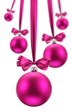 Christmas balls hanging pink ribbons on holiday. Royalty Free Stock Photos